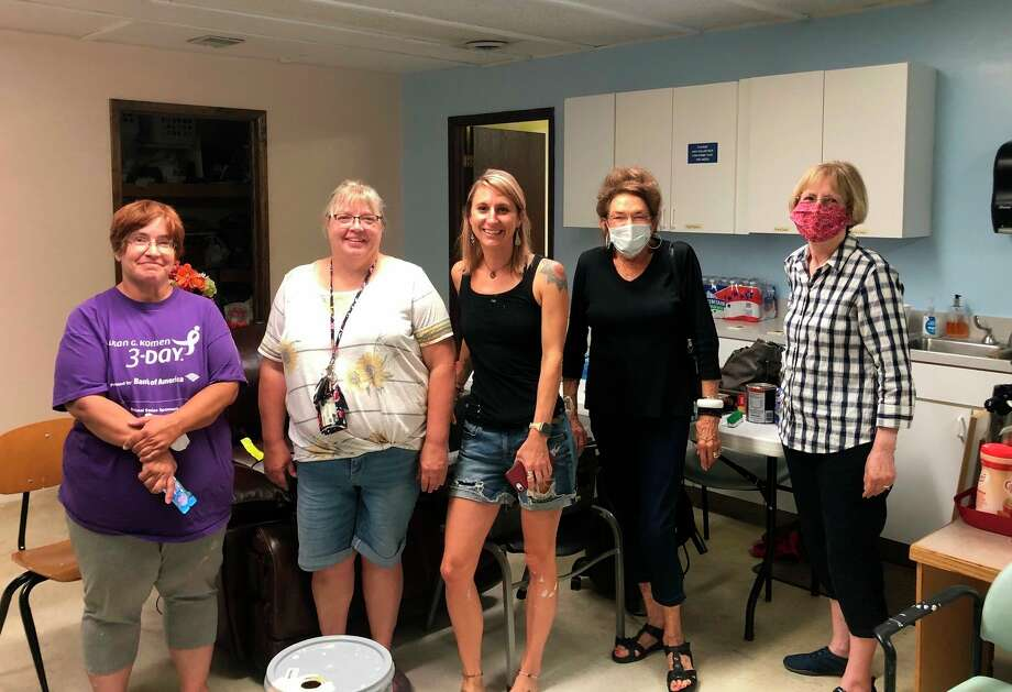 As well as finding joy in helping the residents at the shelter, Horan said she enjoys working with so many people who are also looking to help the community. Featured is a photo from last week when Horan (second from the right) and a group of volunteers worked on shelter renovations in preparation of their upcoming season. (Courtesy photo)