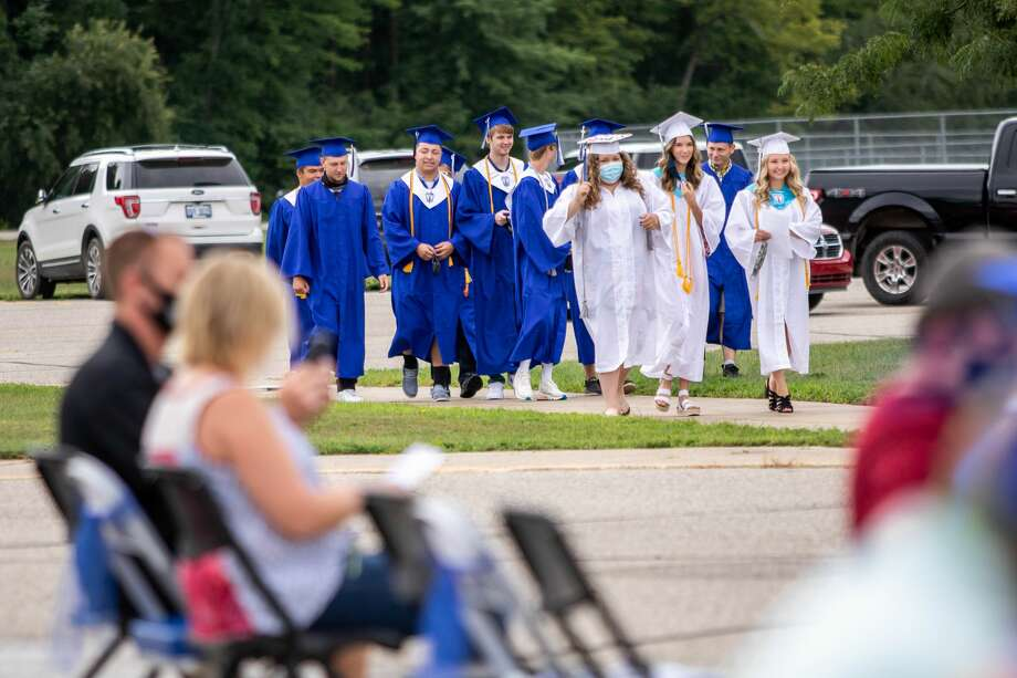 Coleman High School graduates celebrate with their family and friends during a commencement ceremony Sunday, Aug. 2, 2020 at the school. (Cody Scanlan/for the Daily News) Photo: (Cody Scanlan/for The Daily News)