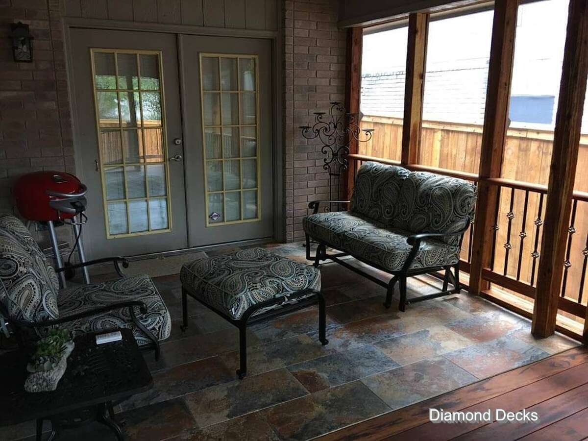 A screened-in porch does the trick of protecting homes from rain, pests and other weather conditions.