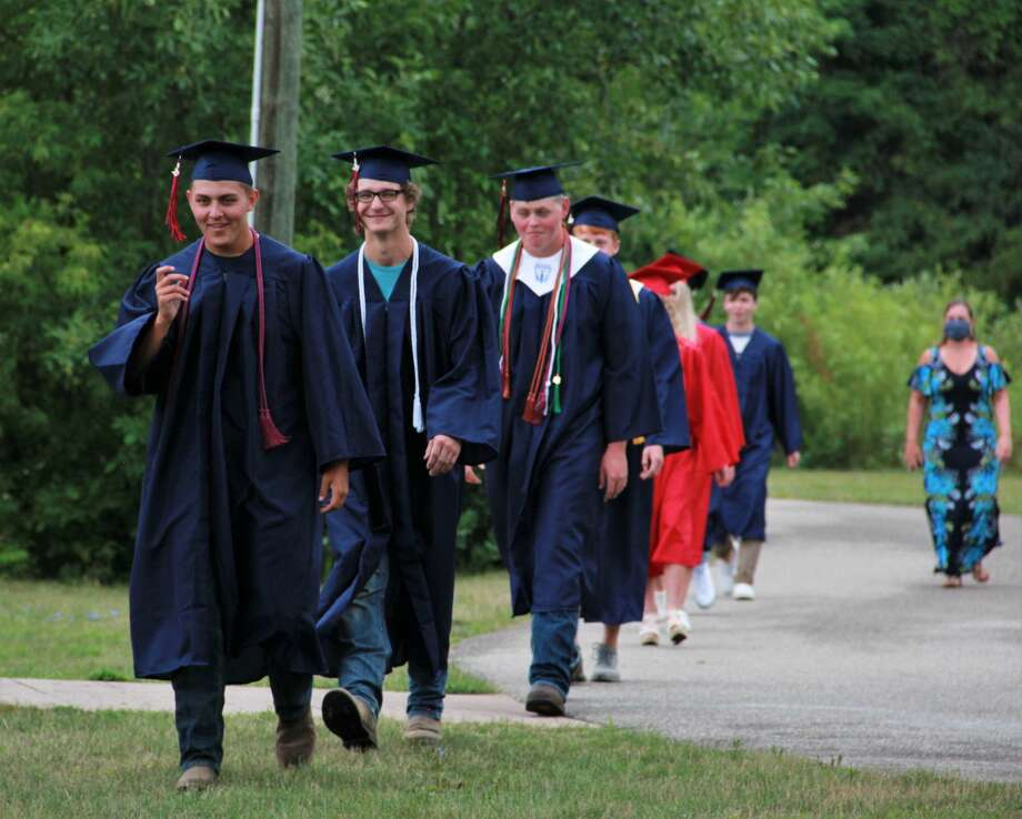 Big Rapids High School seniors became the graduating class of 2020 on Sunday as they gathered for an unexpected graduation ceremony at the Hemlock Park Band Shell. Originally anticipated to take place at the end of the school year at the high school, students had to postpone their celebration because of the coronavirus pandemic.