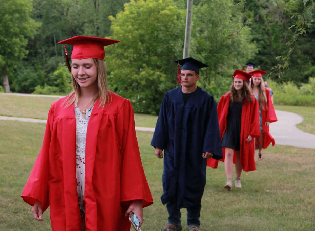 Big Rapids High School seniors became the graduating class of 2020 on Sunday as they gathered for an unexpected graduation ceremony at the Hemlock Park Band Shell. Originally anticipated to take place at the end of the school year at the high school, students had to postpone their celebration because of the coronavirus pandemic. That didn't stop families from gathering to this late, but just-as-exciting event to watch their seniors become graduates, and snag a few memorable photos with family and friends. Masks were provided to guests and graduates, with the students graduating throughout the day in smaller groups to promote social distancing. Featured are a few photos from the day's festivities. To view a completed gallery of the event, visit bigrapidsnews.com.