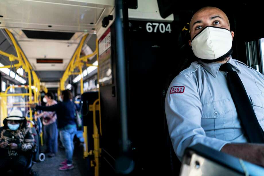 San Francisco MUNI bus driver Felix Castillo workers his route through the Mission neighborhood in San Francisco on July 14, 2020. Photo: Washington Post Photo By Melina Mara / The Washington Post