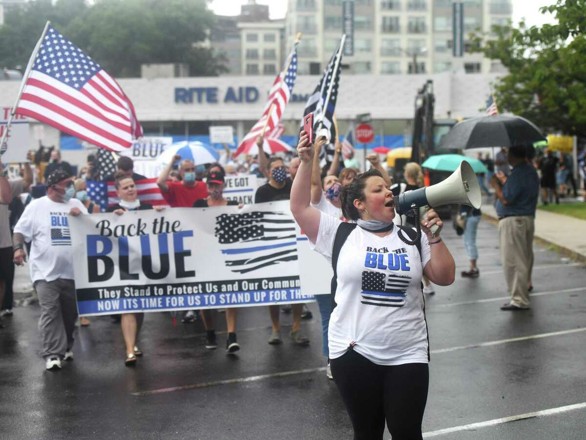 A group marches to the police rally at the old Stamford police station Aug. 2, 2020. Hundreds endured rainfall to show appreciation for the Stamford Police Department.