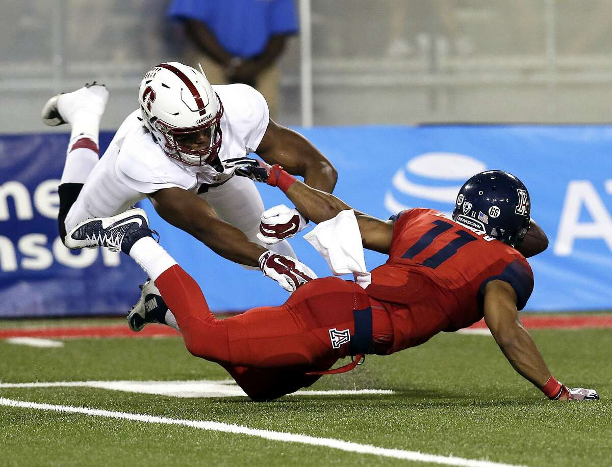 Arizona wide receiver Nate Phillips (11) fumbles the ball after being pressured by Stanford cornerback Treyjohn Butler (6) during the second half of an NCAA college football game, Saturday, Oct. 29, 2016, in Tucson, Ariz. Stanford defeated Arizona 34-10. Butler is among numerous Pac12 football players who have signed onto an open letter addressed to the Pac12 in which they threaten to not participate in team practices or play in games if certain coronavirus-related health concerns, and economic and racial justice demands are not met to the satisfaction of the players.