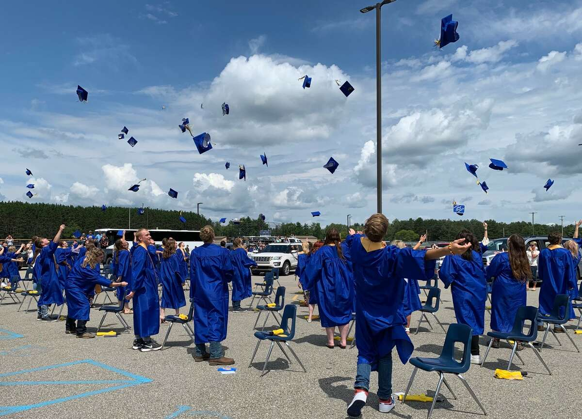 Evart High School held its graduation ceremony at 2 p.m., Sunday, Aug. 1, in the Evart High School parking lot.Parents remained in their vehicles throughout the duration of the ceremony. Graduates, who were seated in front of the stage, wore face coverings, many wearing blue and gold masks with the class of 2020 logo.