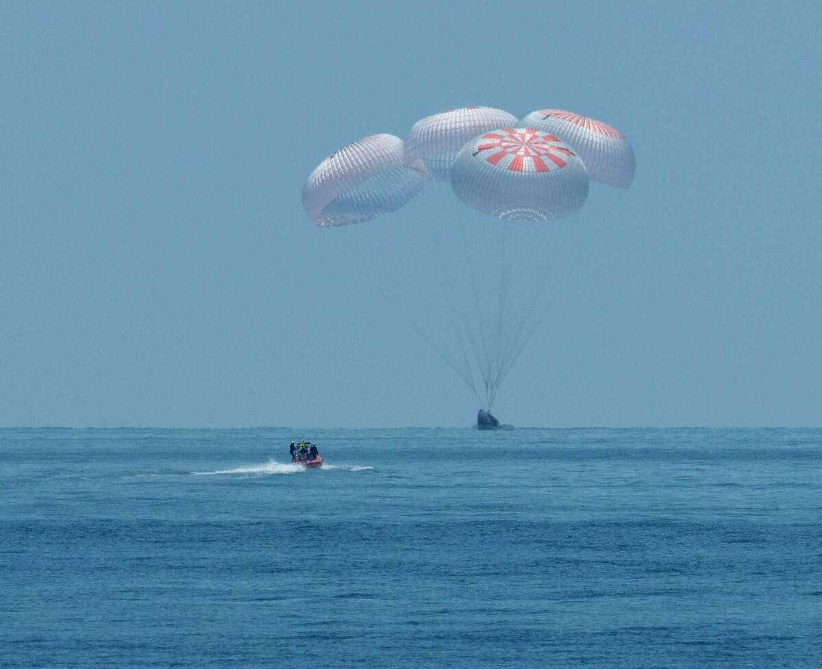 The SpaceX Crew Dragon Endeavour lands on August 2, 2020, with NASA astronauts Bob Behnken and Doug Hurley onboard in the Gulf of Mexico off the coast of Pensacola, Florida. (Photo by BILL INGALLS/NASA/AFP via Getty Images)
