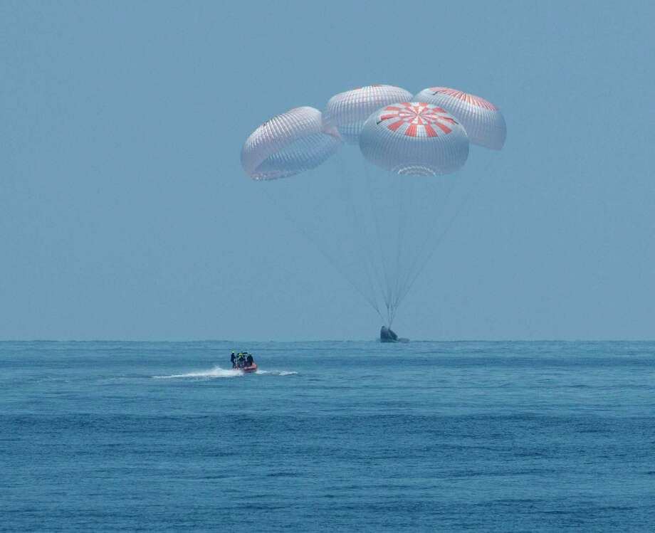 The SpaceX Crew Dragon Endeavour lands on August 2, 2020, with NASA astronauts Bob Behnken and Doug Hurley onboard in the Gulf of Mexico off the coast of Pensacola, Florida. (Photo by BILL INGALLS/NASA/AFP via Getty Images) Photo: BILL INGALLS, Contributor / NASA/AFP Via Getty Images / AFP or licensors