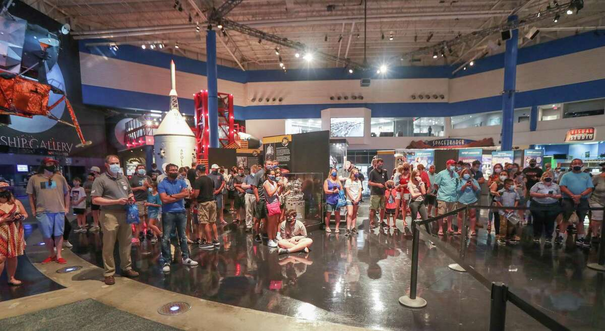 Large screens in Space Center Houston allowed attendees to witness NASA astronauts Bob Behnken and Doug Hurley splash down Sunday, Aug. 2, 2020, in Houston.