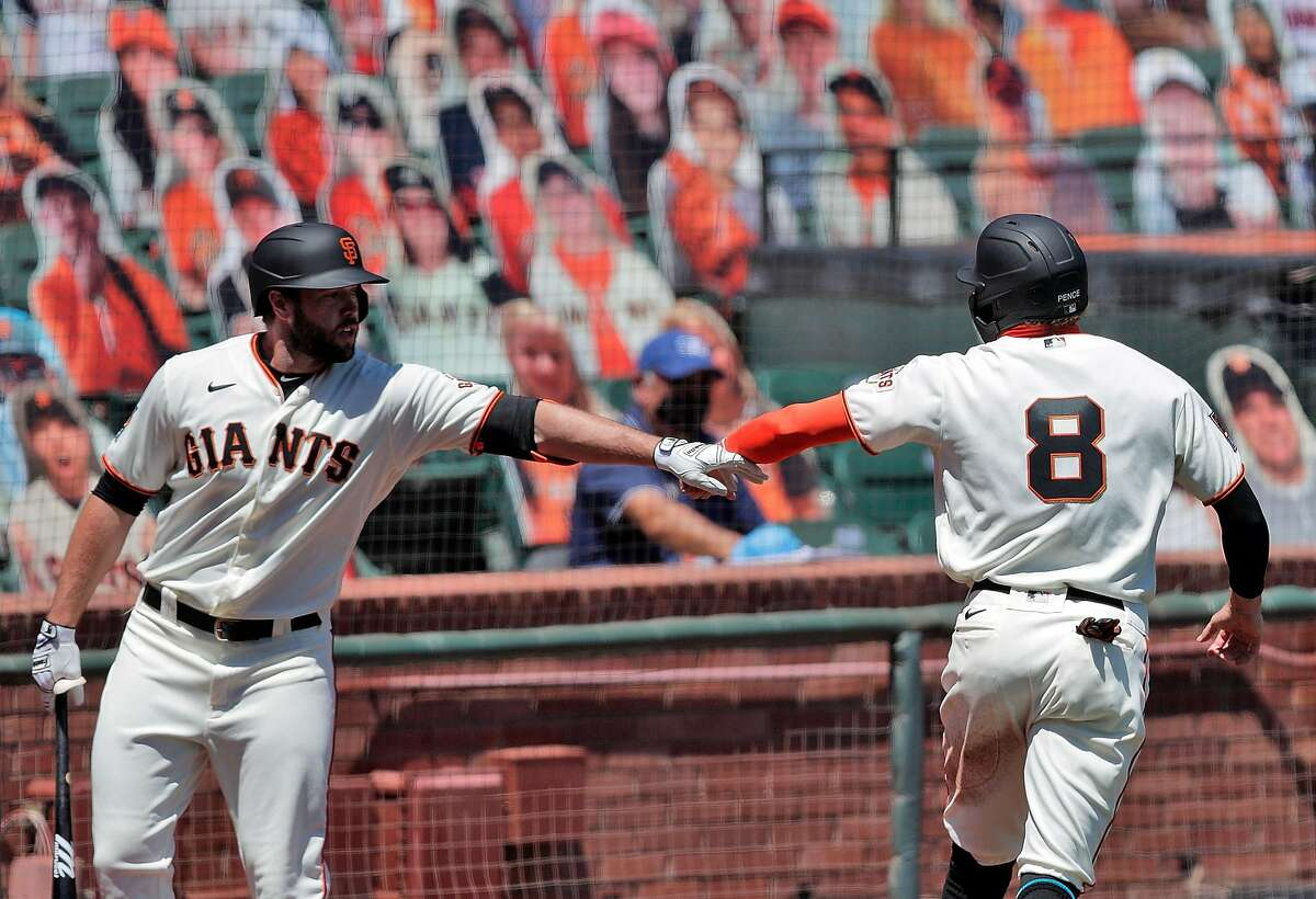 Hunter Pence (8) celebrates scoring on an Evan Longoria (10) sacrifice fly with Darin Ruf (33) as the San Francisco Giants played the Texas Rangers at the Oracle Park in San Francisco, Calif., on Sunday, August 2, 2020.