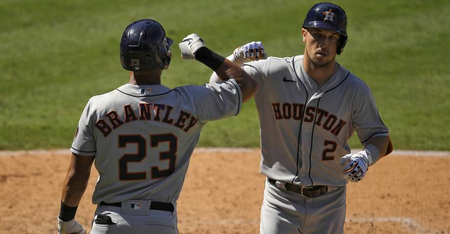 Houston Astros' Alex Bregman, right, is congratulated by Michael Brantley after hitting a solo home run during the seventh inning of a baseball game against the Los Angeles Angels Sunday, Aug. 2, 2020, in Anaheim, Calif. (AP Photo/Mark J. Terrill) Photo: Mark J. Terrill/Associated Press / Copyright 2020 The Associated Press. All rights reserved.