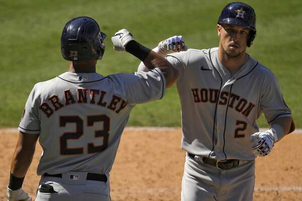 Houston Astros' Alex Bregman, right, is congratulated by Michael Brantley after hitting a solo home run during the seventh inning of a baseball game against the Los Angeles Angels Sunday, Aug. 2, 2020, in Anaheim, Calif. (AP Photo/Mark J. Terrill)