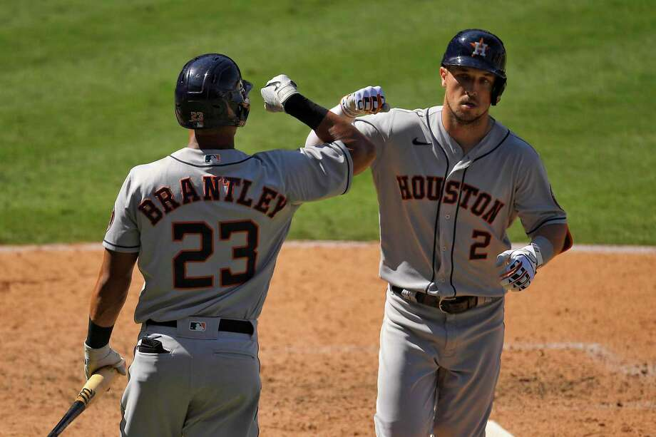 Houston Astros' Alex Bregman, right, is congratulated by Michael Brantley after hitting a solo home run during the seventh inning of a baseball game against the Los Angeles Angels Sunday, Aug. 2, 2020, in Anaheim, Calif. (AP Photo/Mark J. Terrill) Photo: Mark J. Terrill, STF / Associated Press / Copyright 2020 The Associated Press. All rights reserved.