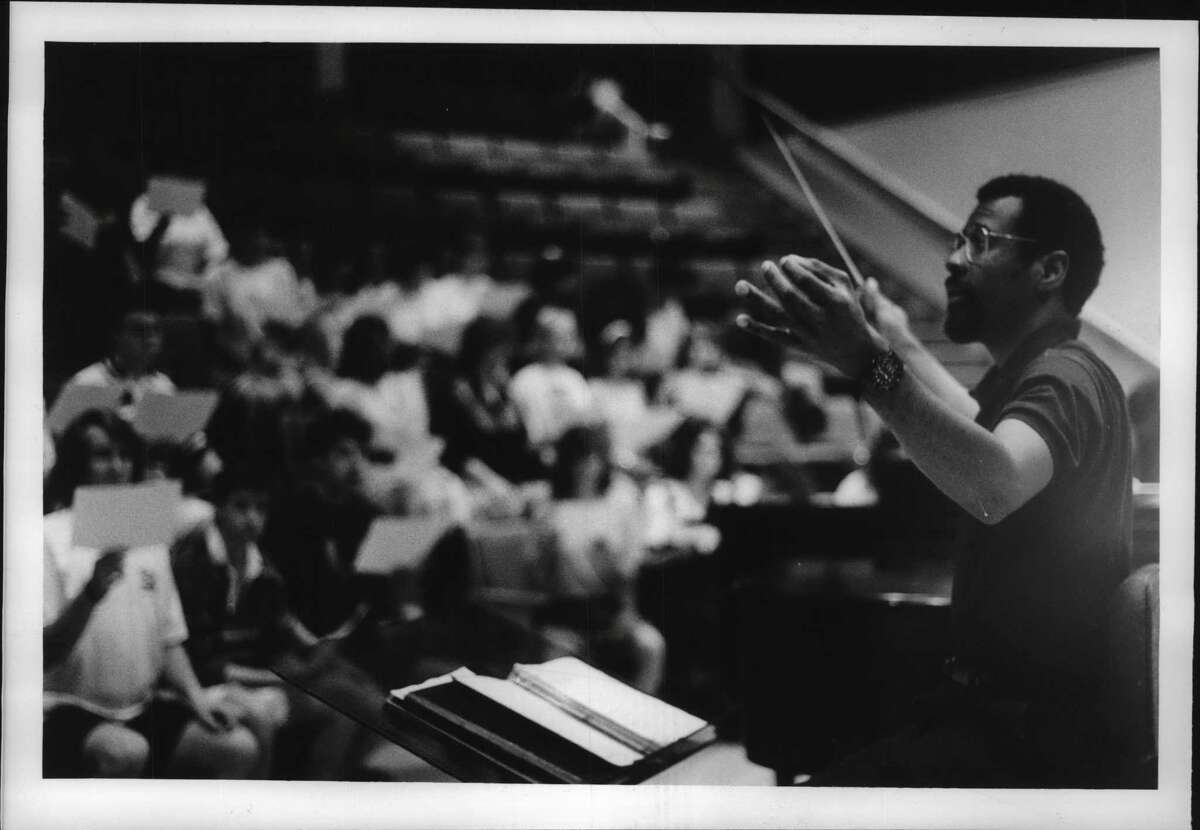 Saratoga Springs, New York - Julius Williams, artistic director of New York State School of Choral Studies at Skidmore College, conducting the chorus at Skidmore. August 3, 1990 (Roberta Smith/Times Union Archive)