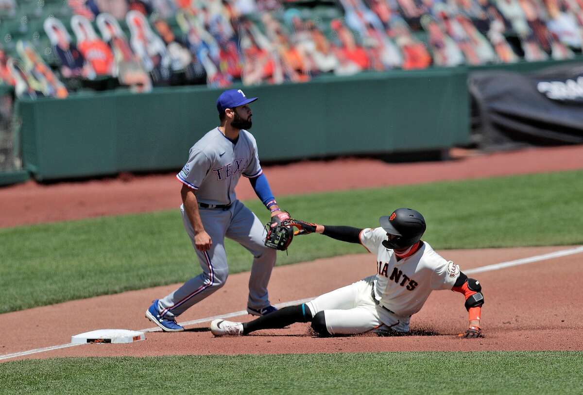 Hunter Pence (8) slides in to third on his second inning triple as the San Francisco Giants played the Texas Rangers at the Oracle Park in San Francisco, Calif., on Sunday, August 2, 2020.