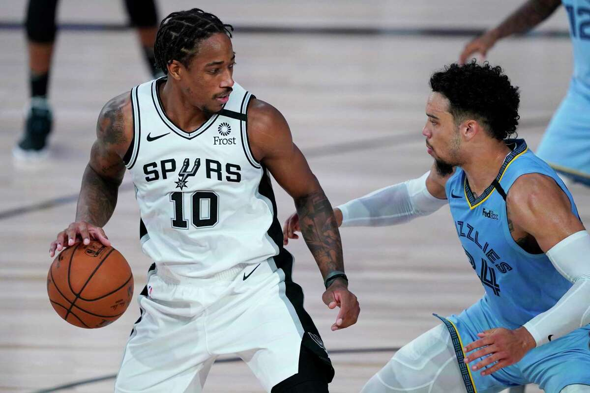 LAKE BUENA VISTA, FLORIDA - AUGUST 02: San Antonio Spurs' DeMar DeRozan #10 dribbles up the court against Memphis Grizzlies' Dillon Brooks #24 during the first half of an NBA basketball game at Visa Athletic Center at ESPN Wide World Of Sports Complex on August 2, 2020 in Lake Buena Vista, Florida. NOTE TO USER: User expressly acknowledges and agrees that, by downloading and or using this photograph, User is consenting to the terms and conditions of the Getty Images License Agreement. (Photo by Ashley Landis-Pool/Getty Images)