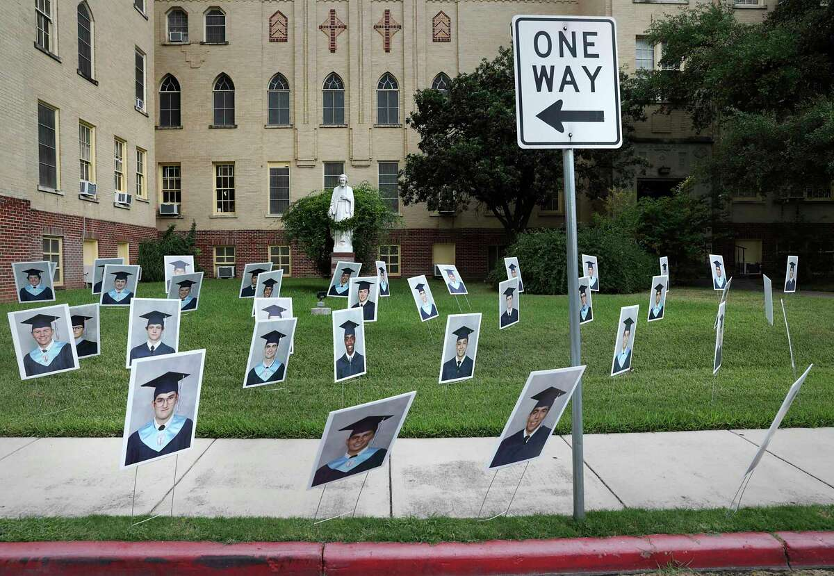Central Catholic High School displayed photos of its 180 graduating students in the yard next to the school's main building in May. Religious schools are moving cautiously toward reopening their campuses for fall classes.