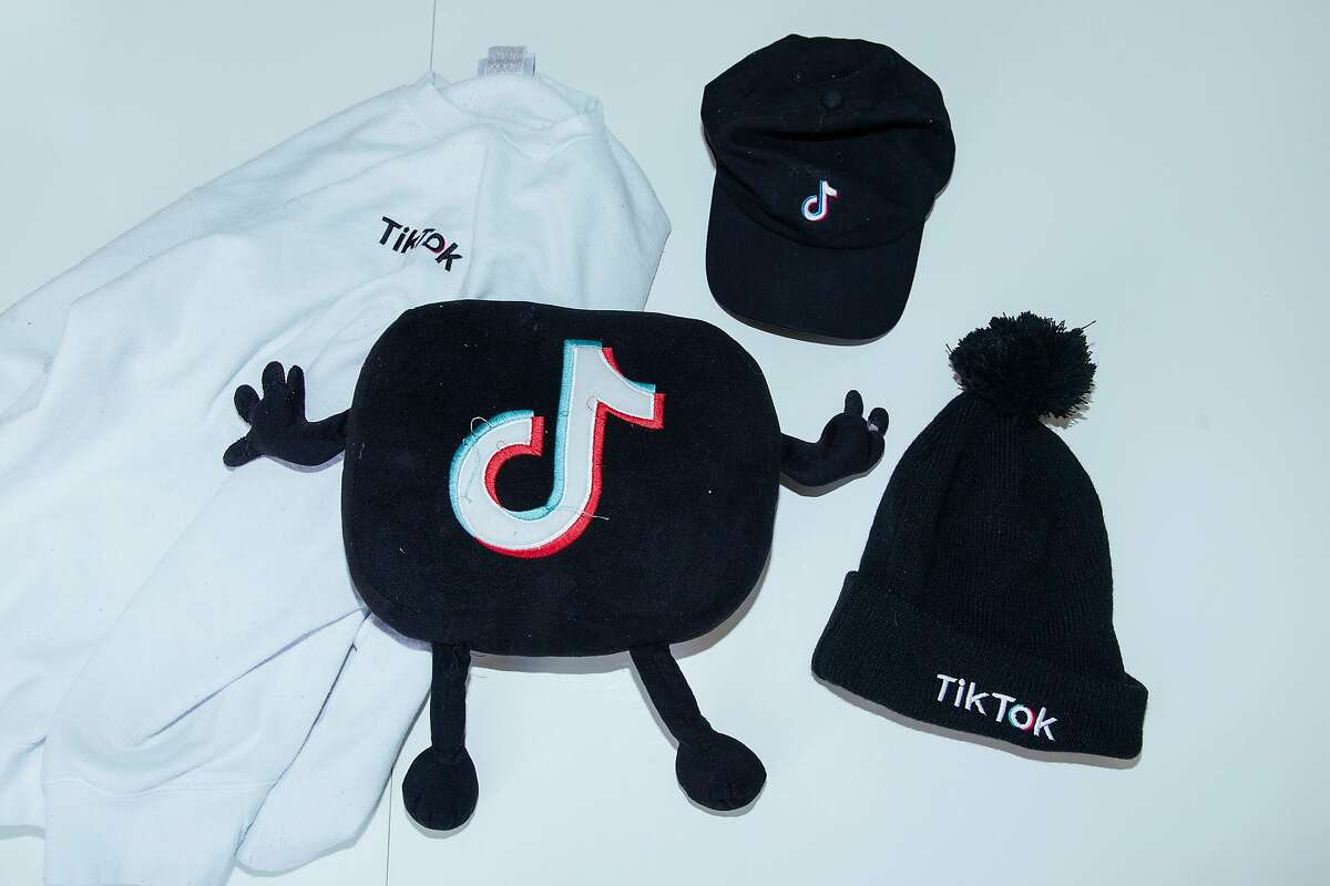 TikTok merchandise owned by Curtis Newbill, who found fame on the app, at his home in Los Angeles, Aug. 2, 2020. With a threat to ban TikTok, President Donald Trump has brought chaos to young creators - and to the entertainment and advertising industries as well. (David Walter Banks/The New York Times)