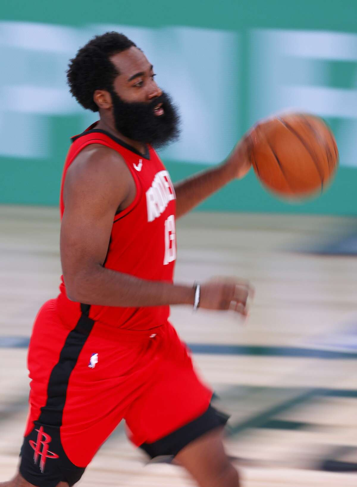 LAKE BUENA VISTA, FLORIDA - AUGUST 02: James Harden #13 of the Houston Rockets moves the ball against the Milwaukee Bucks at The Arena at ESPN Wide World Of Sports Complex on August 02, 2020 in Lake Buena Vista, Florida. NOTE TO USER: User expressly acknowledges and agrees that, by downloading and or using this photograph, User is consenting to the terms and conditions of the Getty Images License Agreement. (Photo by Mike Ehrmann/Getty Images)