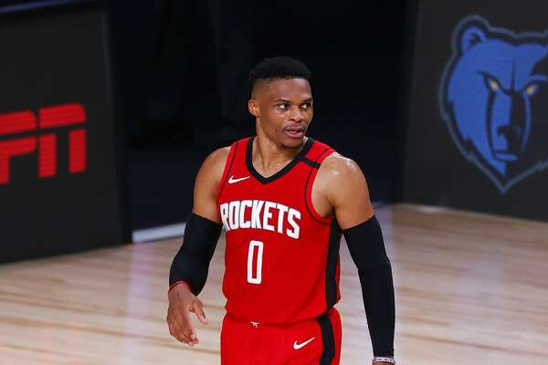 Houston Rockets' Russell Westbrook leaves the court after the team's win over the Milwaukee Bucks in an NBA basketball game Sunday, Aug. 2, 2020, in Lake Buena Vista, Fla. (Mike Ehrmann/Pool Photo via AP)