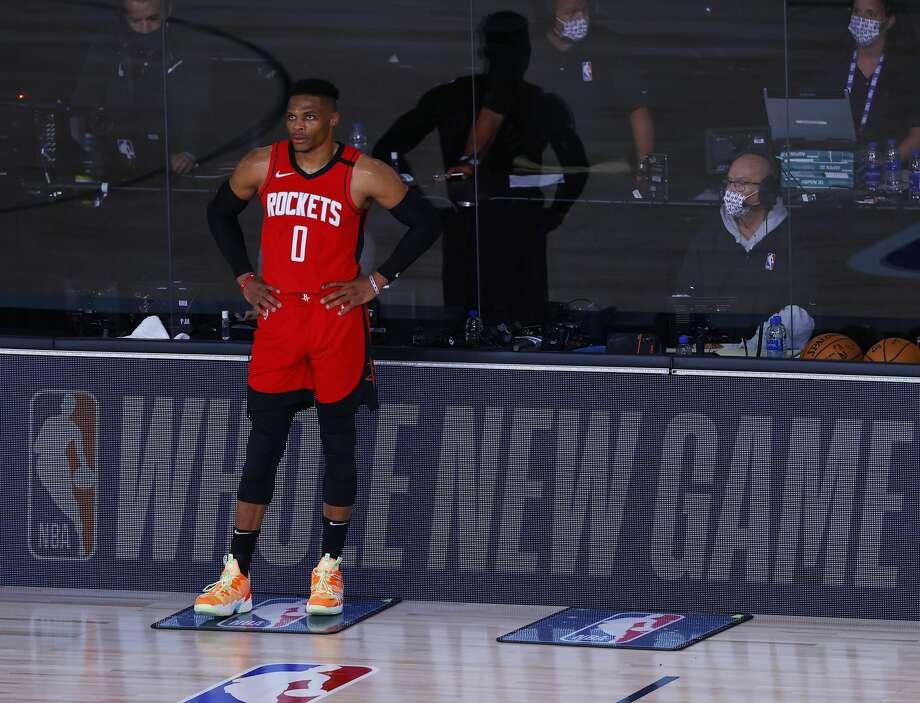Houston Rockets' Russell Westbrook wait to return to the team's NBA basketball game against the Milwaukee Bucks on Sunday, Aug. 2, 2020, in Lake Buena Vista, Fla. (Mike Ehrmann/Pool Photo via AP) Photo: Mike Ehrmann/Associated Press / 2020 Getty Images
