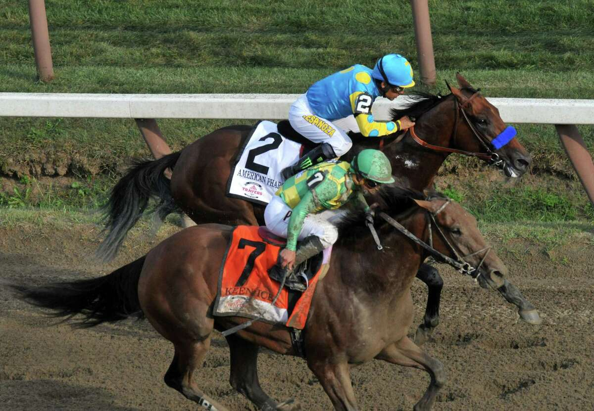 Keen Ice, front, challenges American Pharoah for the lead during The Travers Stakes at Saratoga Race Course on Saturday, Aug. 29, 2015, in Saratoga Springs, N.Y. (Phoebe Sheehan/Special to The Times Union)