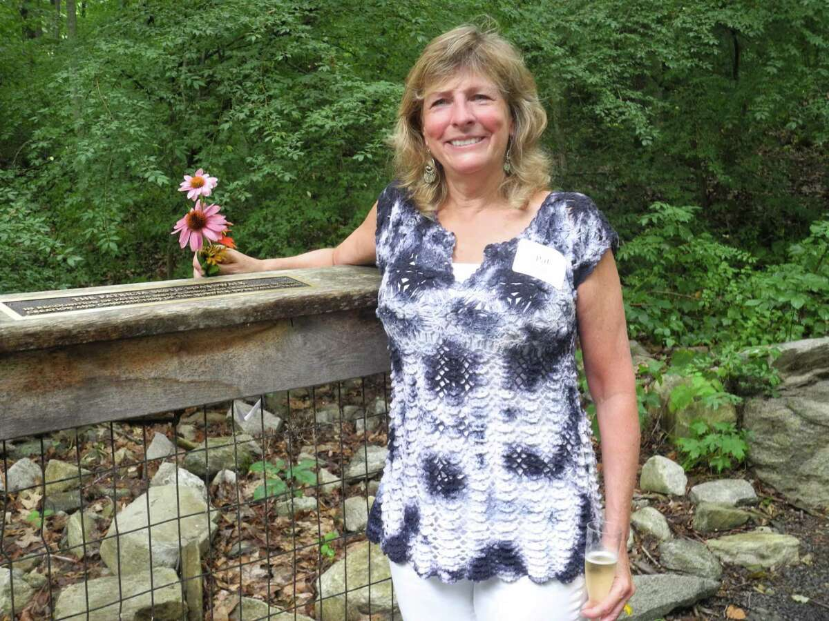 Patricia Sesto, who lives in Ridgefield and worked as Wilton's director of environmental affairs until 2015, stands at the edge of the boardwalk named in her honor along the Norwalk River Valley Trail on July 30. Her longtime friend, and fellow trail supporter, Helen Rendell-Baker, recalled taking a walk along a