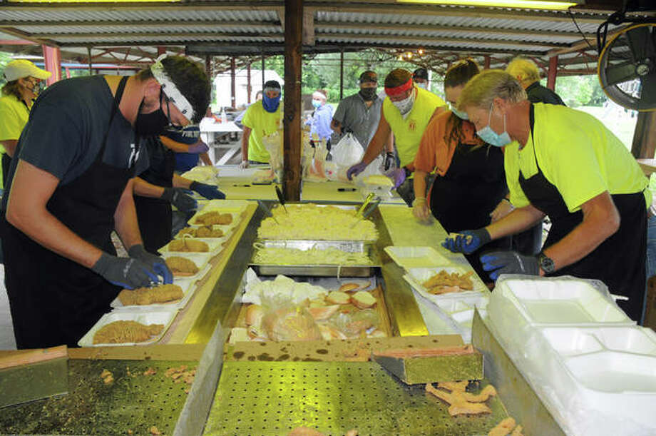 Volunteers prepare meals during the Dorchester Volunteer Fire Department Fish Fry. Photo: David Blanchette   For Hearst Illinois