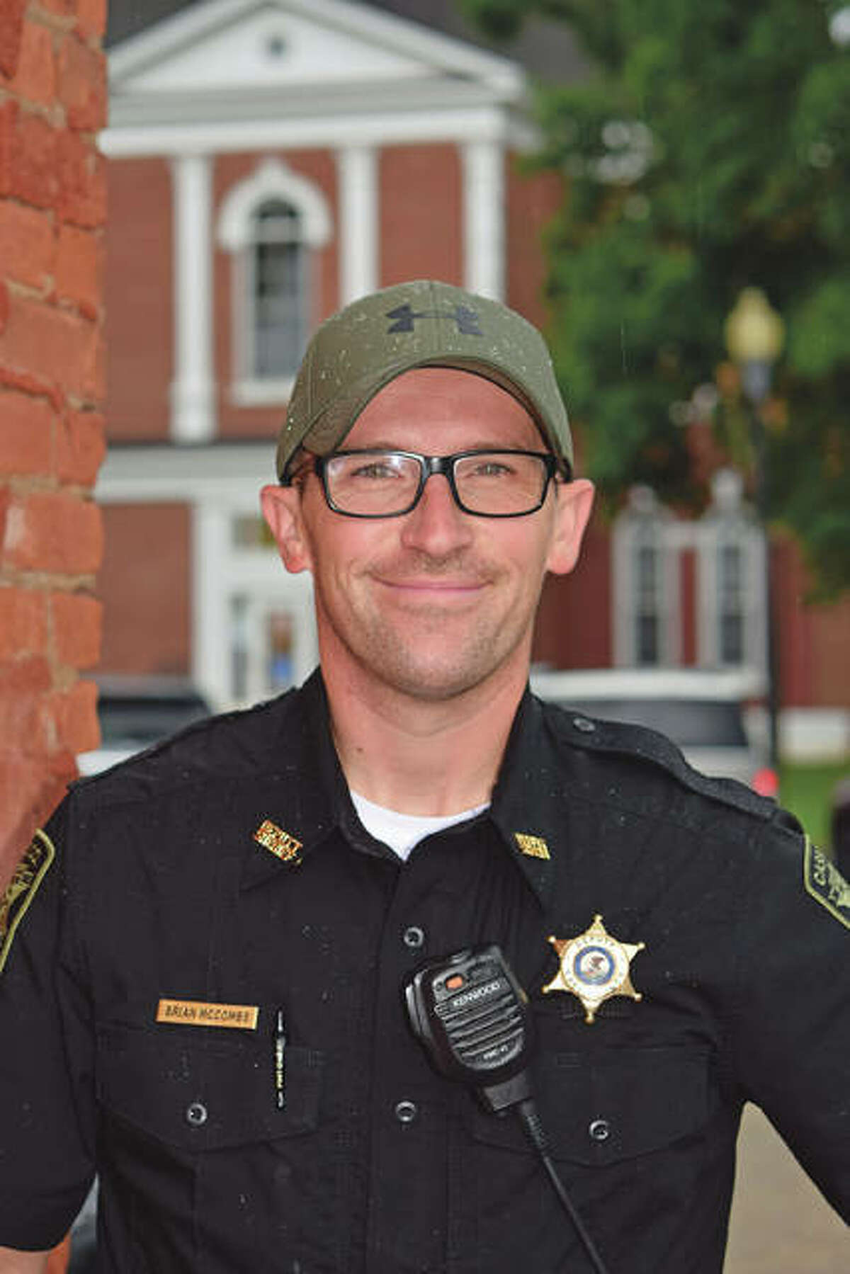 Cass County Sheriff's Deputy Brian McCombs in downtown Virginia, with the Cass County Courthouse in the background.