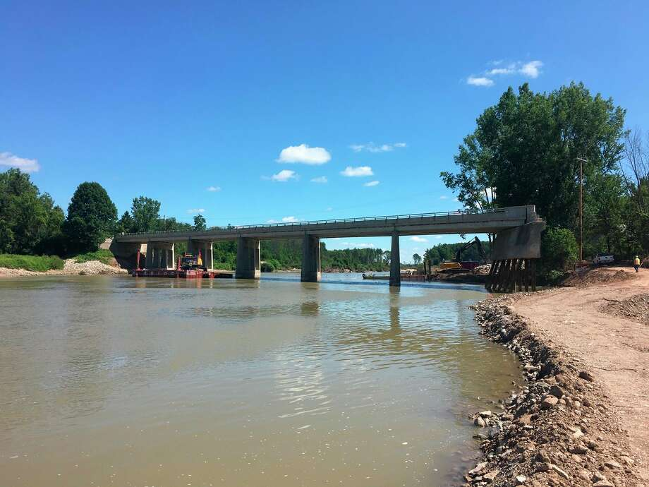 M-30 at the Tittabawassee River has been cleared of debris and emergency repairs to retrofit the existing piers and rebuild road and bridge approach begin Aug. 3. (Photo provided/ Michigan Department of Transportation).