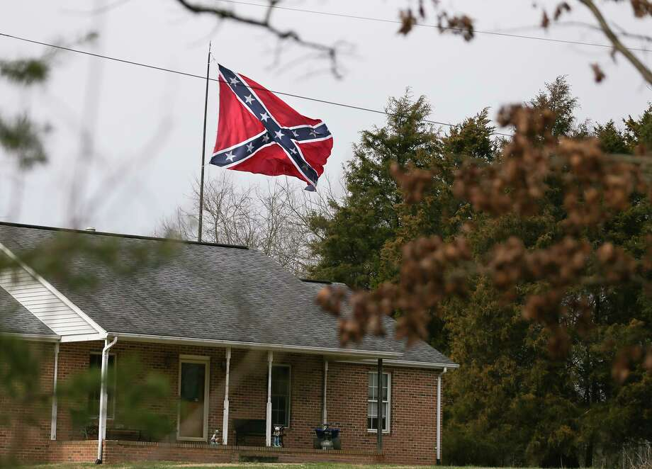 A Confederate flying on a house in Virginia. Photo: Associated Press / The Free Lance-Star