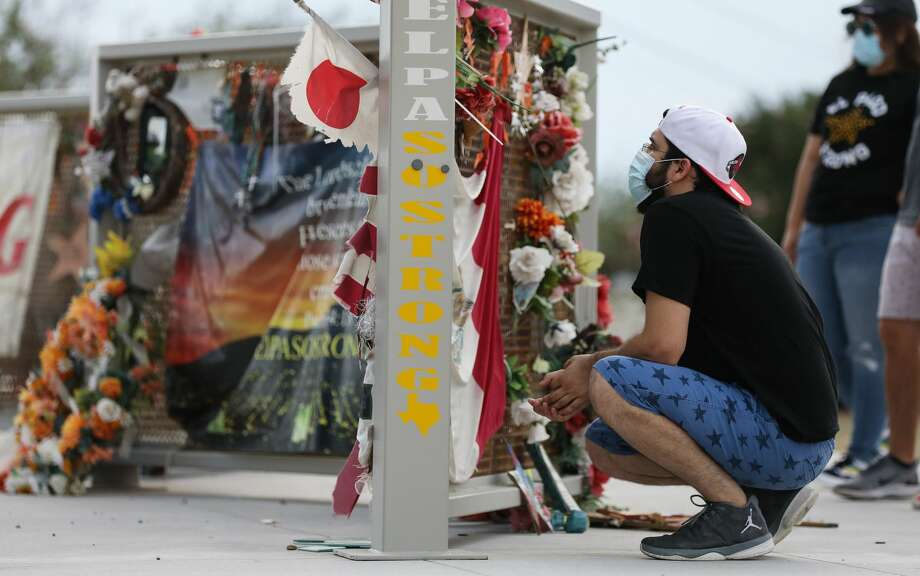 People view a temporary memorial in Ponder Park honoring victims of the Walmart shooting which left 23 people dead in a racist attack targeting Latinos on August 2, 2020 in El Paso, Texas. August 3rd marks the one-year anniversary of the deadliest attack against Hispanics in modern U.S. history. A number of memorial events are planned amid the COVID-19 pandemic in the Texas city which sits along the U.S.-Mexico border. (Photo by Mario Tama/Getty Images) Photo: Mario Tama/Getty Images / 2020 Getty Images
