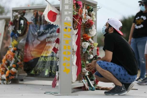 EL PASO, TEXAS - AUGUST 02: People view a temporary memorial in Ponder Park honoring victims of the Walmart shooting which left 23 people dead in a racist attack targeting Latinos on August 2, 2020 in El Paso, Texas. August 3rd marks the one-year anniversary of the deadliest attack against Hispanics in modern U.S. history. A number of memorial events are planned amid the COVID-19 pandemic in the Texas city which sits along the U.S.-Mexico border. (Photo by Mario Tama/Getty Images)