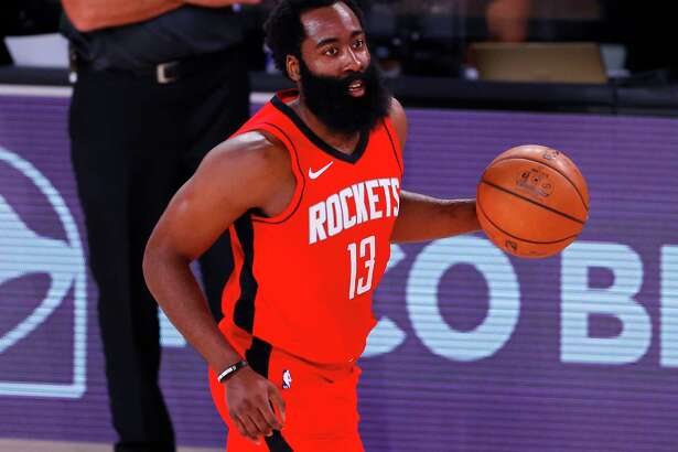 LAKE BUENA VISTA, FLORIDA - AUGUST 02: James Harden #13 of the Houston Rockets moves the ball against the Milwaukee Bucks at The Arena at ESPN Wide World Of Sports Complex on August 02, 2020 in Lake Buena Vista, Florida. NOTE TO USER: User expressly acknowledges and agrees that, by downloading and or using this photograph, User is consenting to the terms and conditions of the Getty Images License Agreement.