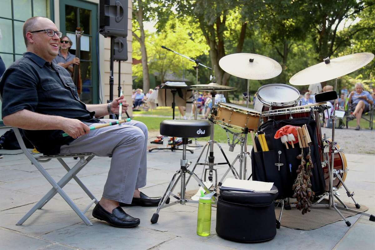 Drummer Ben Bilello gets ready for the set at the Fairfield Museum and History Center's Jazz Friday concert on July 31, 2020, in Fairfield, Conn.