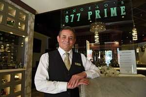 Mark Bowman, 677 Prime's most senior server, stands inside 677 Prime on Friday, July 31, 2020 in Albany, N.Y. (Lori Van Buren/Times Union)