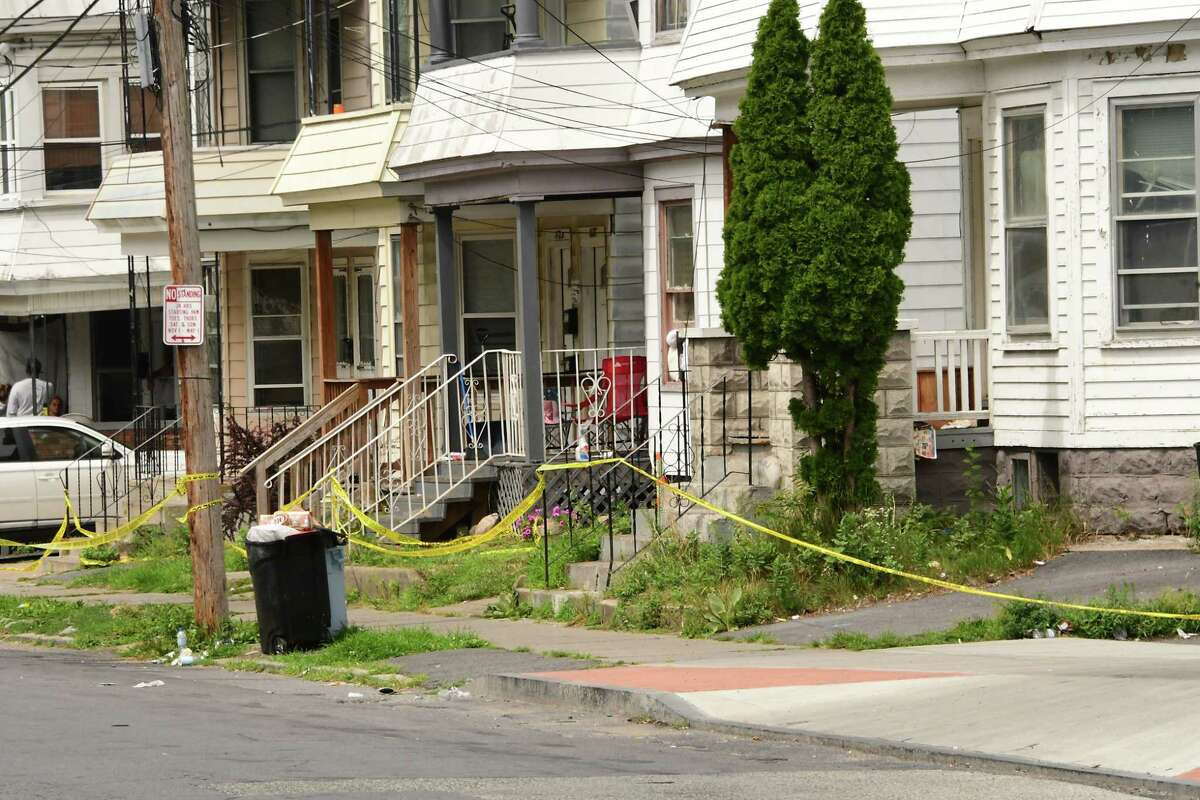 Police tape is seen in front of many homes at the scene where a woman was killed Sunday night on Sixth Avenue Monday, August, July 3, 2020 in Schenectady, N.Y. (Lori Van Buren/Times Union)