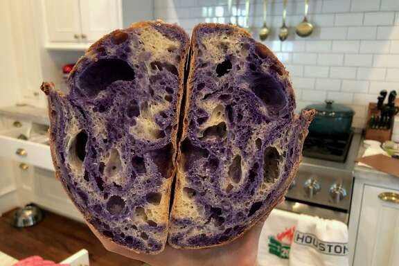 Heights resident Lily Cheung is an engineer who has been baking with a sourdough starter given to her by Jan Young, a neighbor. These loaves were made with butterly pea flower that lends the bread a purple color.