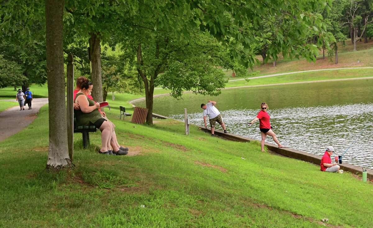 People are seen walking, reading and fishing along Iroquois Lake in Central Park on August, July 3, 2020 in Schenectady, N.Y. (Lori Van Buren/Times Union)