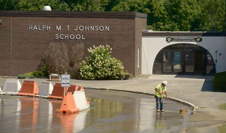 A worker clears away dirt from the driveway of Ralph M.T. Johnson School on Friday afternoon. Renovation work will continue at Johnson and Rockwell schools thru the school year. Friday,August 30, 2019, in Bethel, Conn. Photo: H John Voorhees III / Hearst Connecticut Media / The News-Times