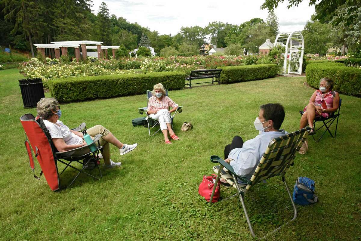 From left, friends Esta Skoburn, Vette Kraut, Susan Jarrett and Elissa Freedman, all of Schenectady, enjoy a socially distanced lunch in the Central Park Rose Garden on August, July 3, 2020 in Schenectady, N.Y. (Lori Van Buren/Times Union)
