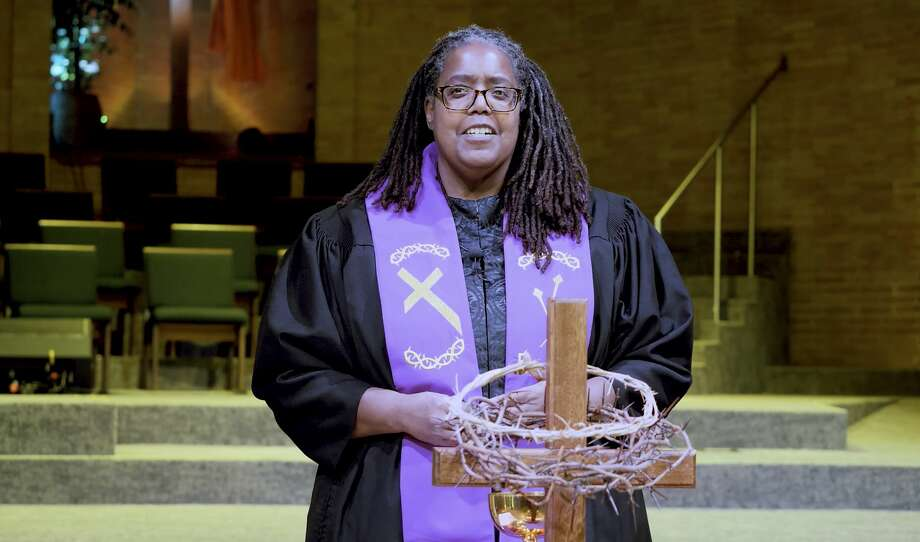 Reverend Vickey Gibbs stands before the communion table on Pentecost Sunday.
