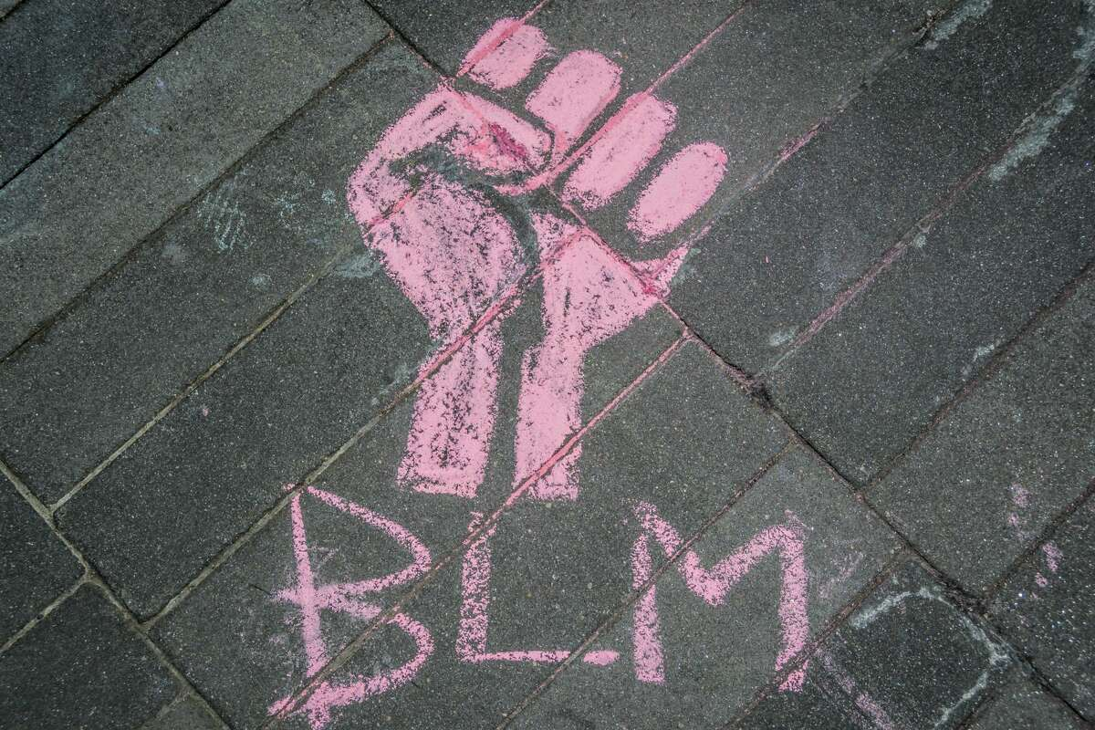 File photo of Black Lives Matter chalk art seen at a protest in Brooklyn, New York on June 17, 2020.