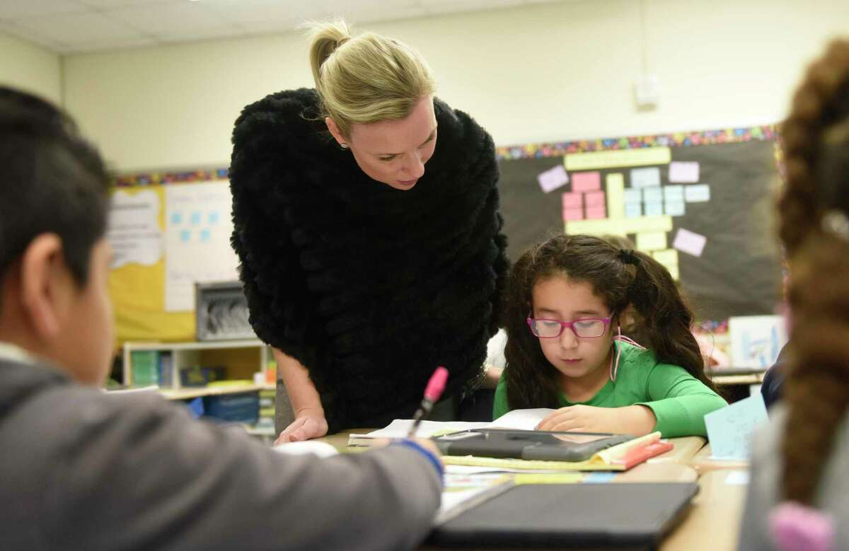 Then-assistant principal Klara Monaco talks with third-grader Dayanna Dies during the Teachers College training session at New Lebanon School in the Byram section of Greenwich, Conn. Tuesday, Nov. 29, 2016. The Columbia University Teachers College Reading and Writing Project came to New Lebanon for a professional development day promoting effective teaching strategies.