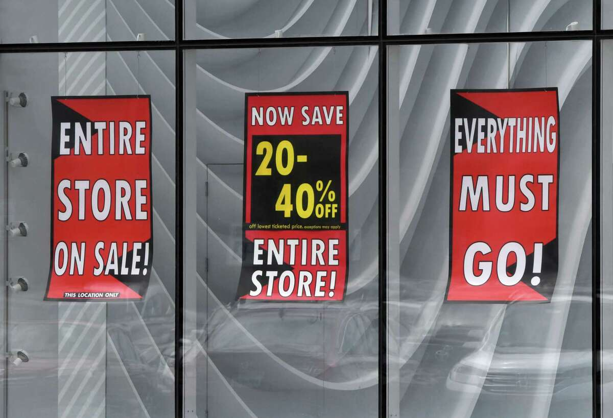 Signs in the windows of Lord & Taylor at Crossgates Mall advise of its closing on Monday Aug. 3, 2020, in Guilderland, N.Y. The department store company has filed for bankruptcy. (Will Waldron/Times Union)