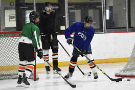 Three members of the EHS ice hockey team run through a drill earlier this summer inside the East Alton Ice Arena.