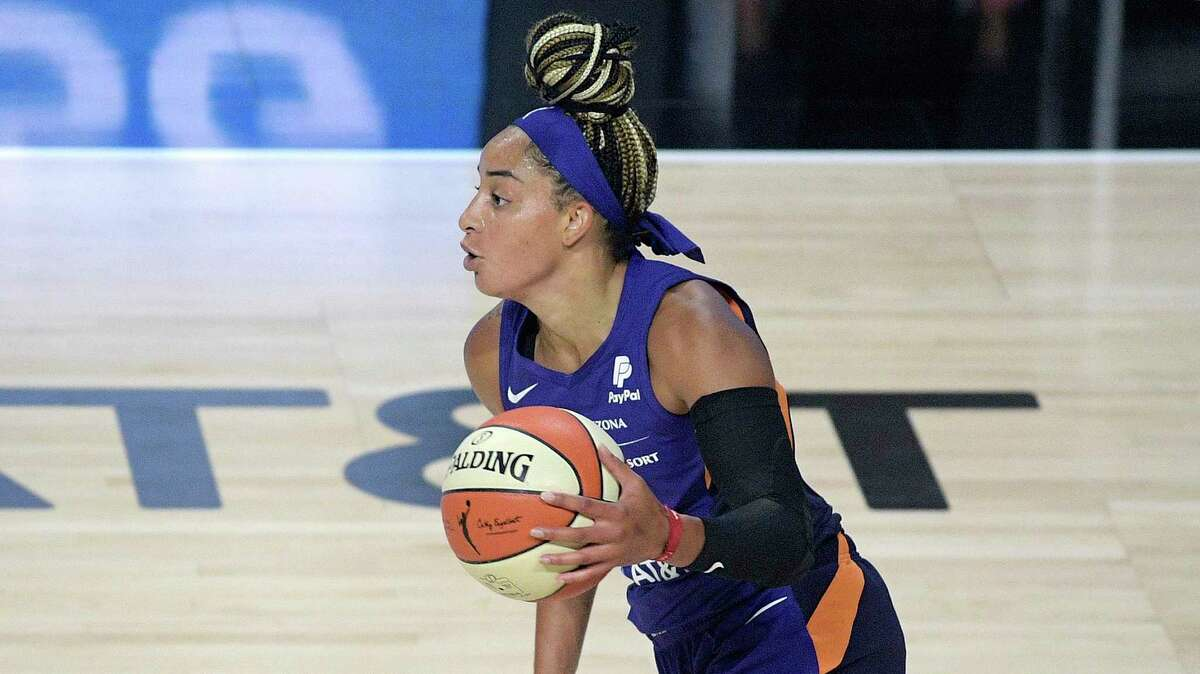 Phoenix Mercury guard Bria Hartley brings the ball up the court during the first half of a WNBA basketball game against the Los Angeles Sparks, Saturday, July 25, 2020, in Bradenton, Fla. (AP Photo/Phelan M. Ebenhack)