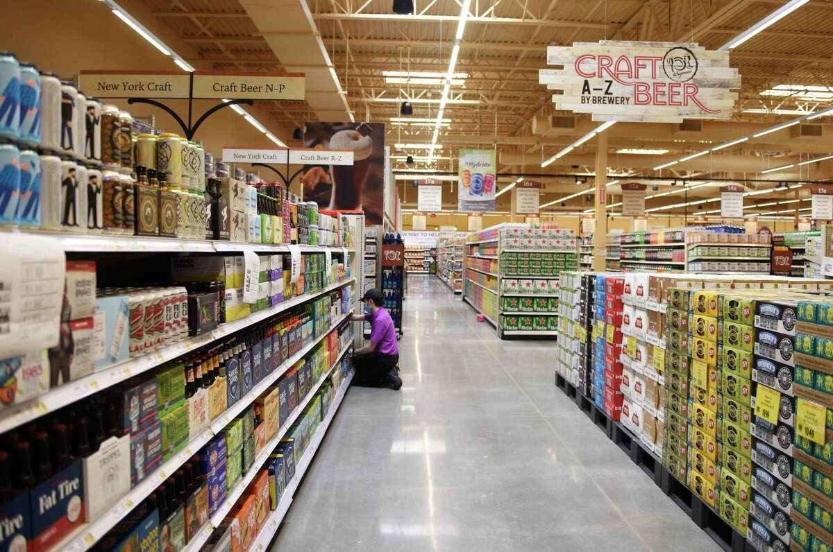 Many aisles of craft beer are stocked at the new Wegmans supermarket in Harrison, N.Y. Monday, Aug. 3, 2020. The 121,000 sq. ft. store features prepared food and restaurant options, as well as an enormous variety of groceries and household essentials. Located just off Interstate 287, Wegmans will officially open for business on Wednesday at 9 a.m.