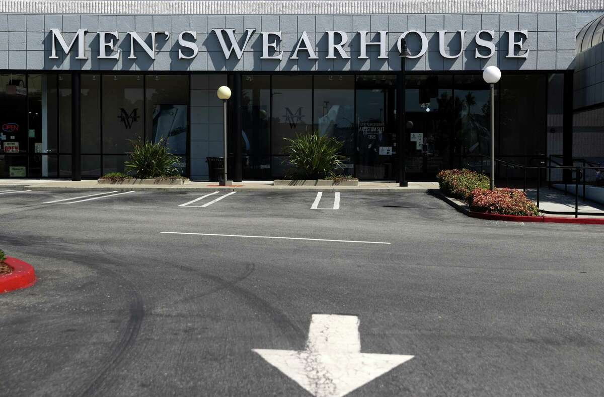 COLMA, CALIFORNIA - AUGUST 03: Exterior view of a Men's Wearhouse clothing store on August 03, 2020 in Colma, California. Tailored Brands Inc., the parent company of Jos a Bank and Men's Wearhouse, filed for Chapter 11 bankruptcy protection after suffering from coronavirus-related store shutdowns. The company cut twenty percent of its workforce and plans to close 500 stores. First-quarter sales were down 60%. (Photo by Justin Sullivan/Getty Images)