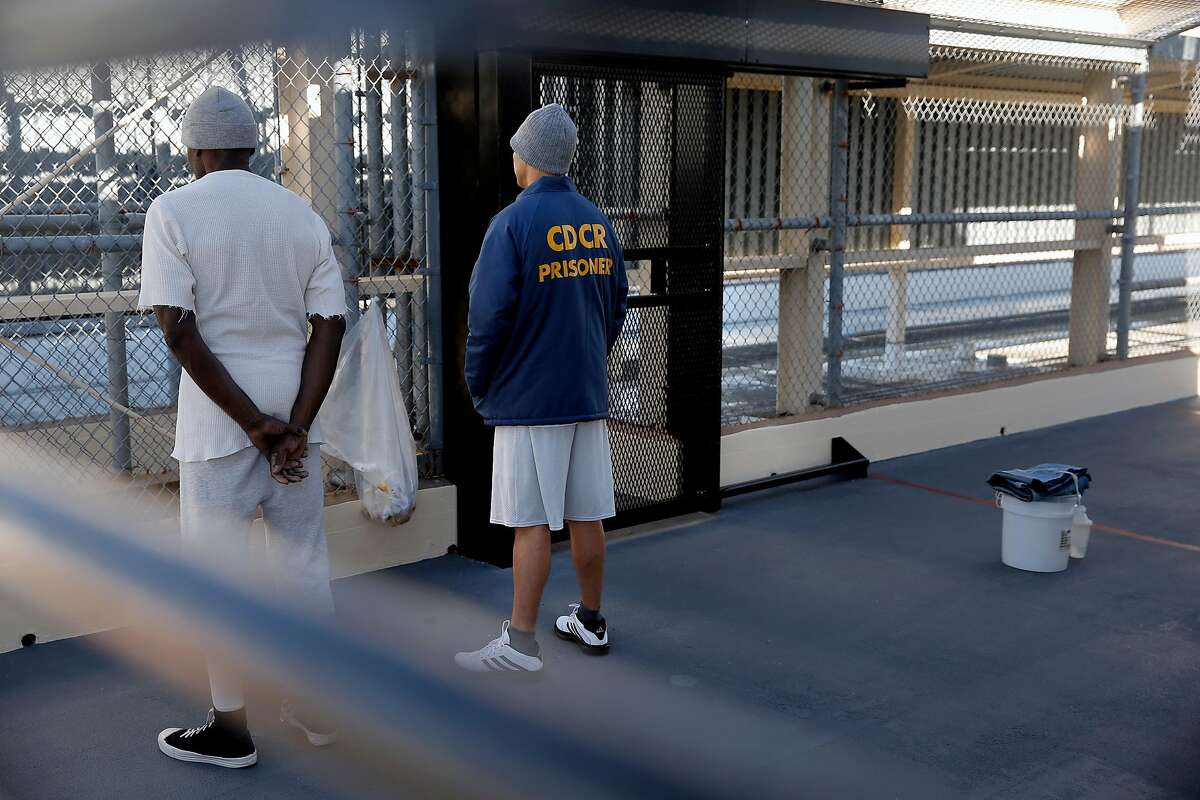 Condemned prisoner Scott Peterson, (right) with a fellow inmate is seen in the exercise area of during a tour of North Segregation of death row at San Quentin State Prison on Tuesday December 29, 2015, in San Quentin, Calif. Peterson was guilty of the murder of his wife Laci Peterson back in 2002.