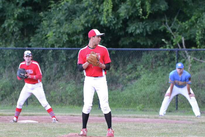 Alex Wiggetman of Fairfield Senior American Legion delivers a pitch as Sam Weinstein plays first base.
